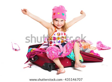 little girl sitting in a closed suitcase