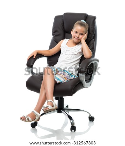 little girl sitting in big office armchair on white background