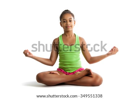 Little girl sitting in lotus position and hands up isolated on white background