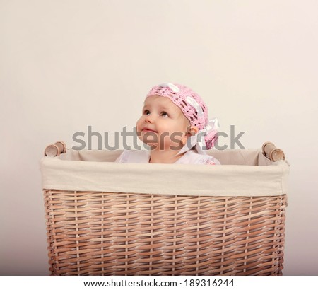 little girl sitting in the basket