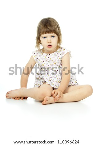 little girl sitting on a white background - stock photo