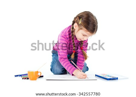 Little girl sitting on floor and drawing