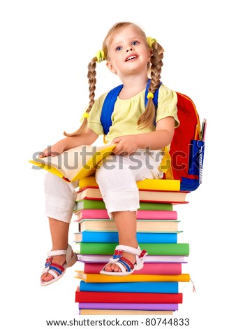 Little girl sitting on pile of books. Isolated. - stock photo