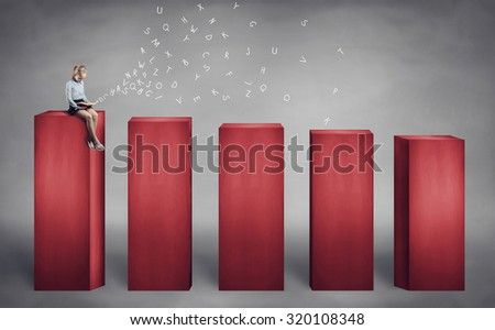 little girl sitting on the top step and reading a book - stock photo