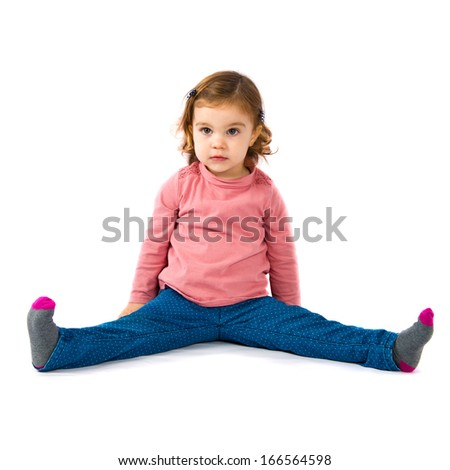 Little girl sitting over white background