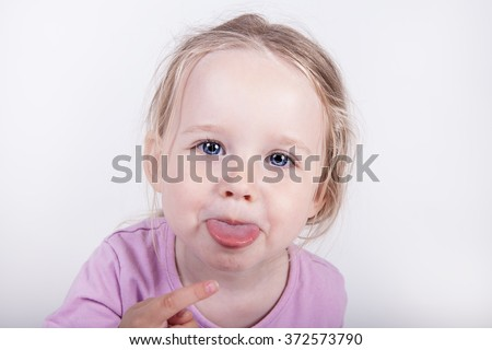 little girl  sitting yelling showing open mouth tongue isolated on a white background - stock photo