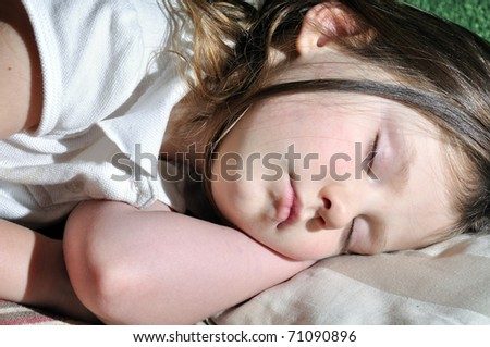 little girl sleeping at home