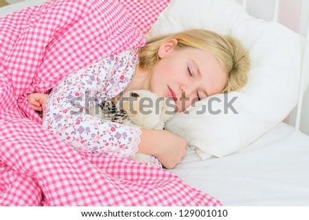 little girl sleeping in bed - stock photo