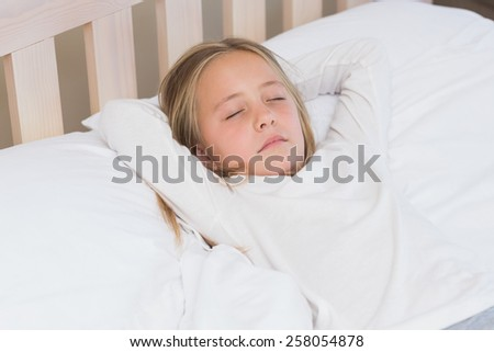 Little girl sleeping in her bed at home in the bedroom