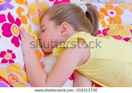 Little girl sleeping on pillow - stock photo