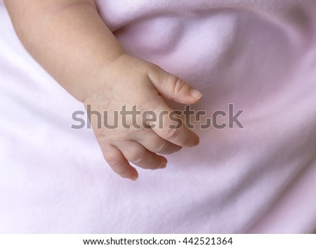 little girl sleeping on the hand of the mother - stock photo