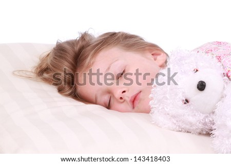 Little girl sleeping with a bear