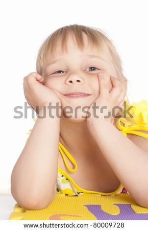 little girl smiles on a white background - stock photo