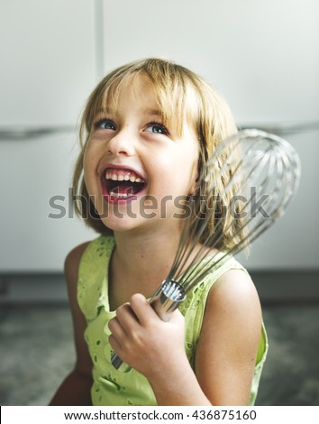 Little Girl Smiling Bake Cookie Concept - stock photo