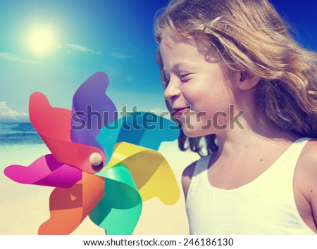 Little Girl Smiling Playing Beach Summer WIndy Concept - stock photo