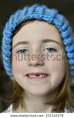 Little girl smiling portrait missing front tooth - stock photo