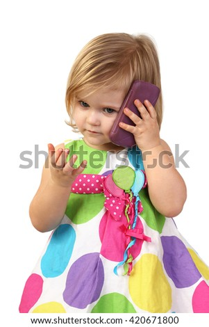 Little girl speaks by cell phone close up isolated on white background - stock photo