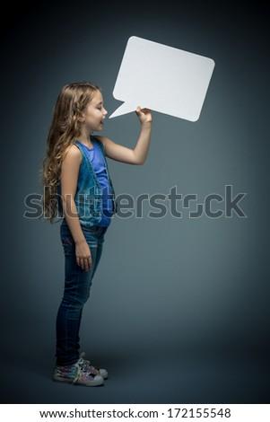 Little girl speaks in bubbles - stock photo