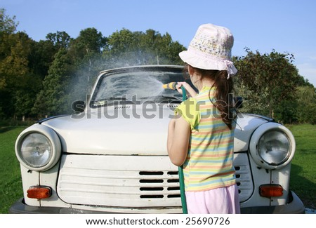 little girl spraying a car with a water hose in a sunny afternoon, rubber hose, pour water on over