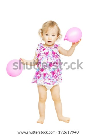 Little girl standing holding balloons. Isolated white