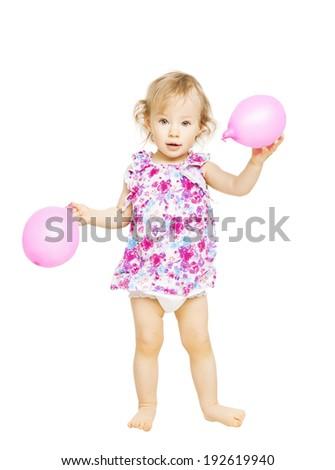 Little girl standing holding balloons. Isolated white  - stock photo