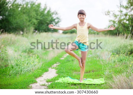 Little girl standing in tree yoga position - stock photo