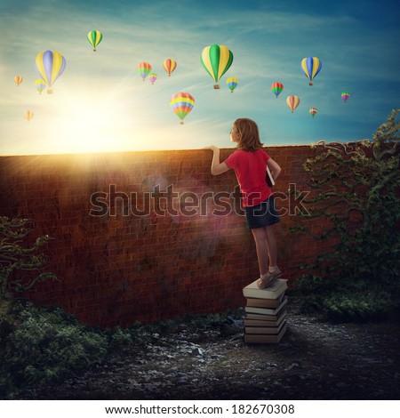 Little girl standing on the books - stock photo