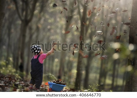 Little girl staring into woods - stock photo