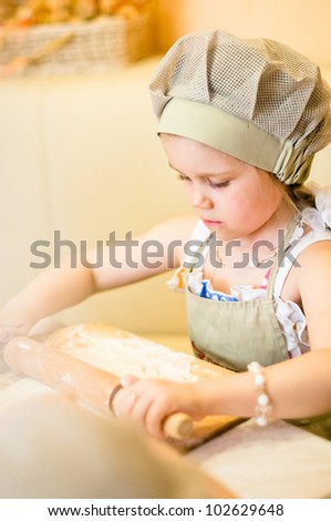 Little girl start cooking pizza and working with dough - stock photo