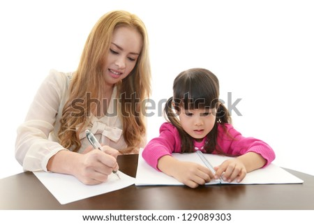 Little girl studying with teacher