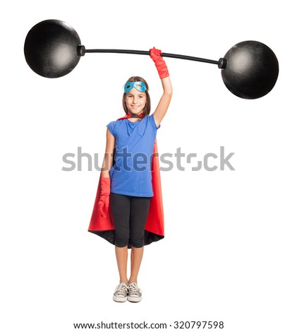 little girl superhero holding a heavy weight on white background - stock photo