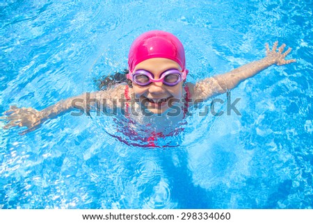 little girl  swimming in the pool  - stock photo