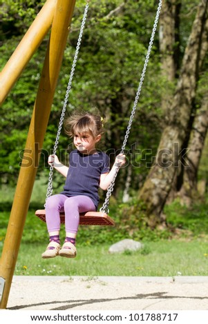 Little girl swingign