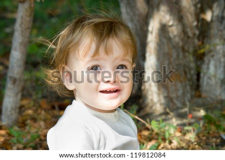 little girl taken closeup outdoors in summer - lighting effect - stock photo