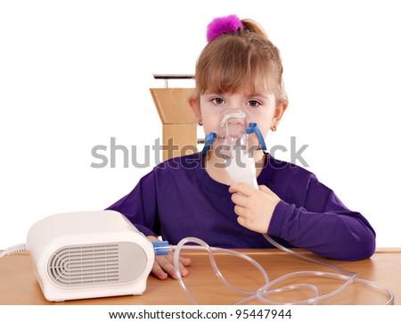 little girl taking inhaler - stock photo