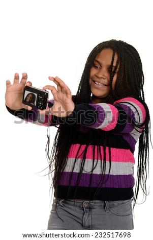 little girl taking selfie - stock photo