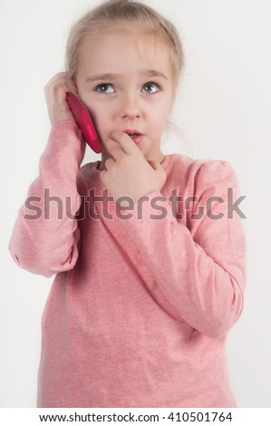 Little girl talking on cellphone - stock photo