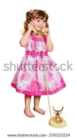 little girl talking on retro phone isolated on white - stock photo