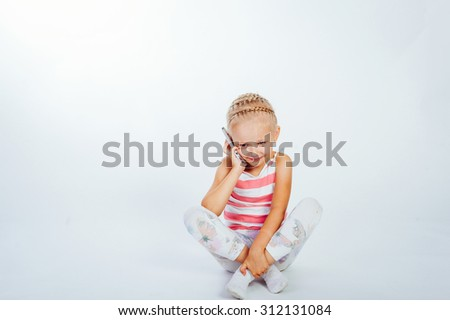 little girl talking on the phone