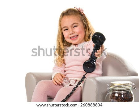 Little girl talking to vintage phone