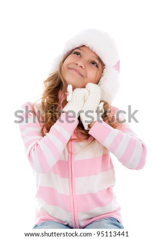 Little girl teenager in winter hat and gloves happy smile looking up to empty copy space, isolated over white background - stock photo