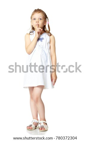 Little girl, the gesture is quiet. The concept of secrecy, games, observance of silence. Isolated over white background
