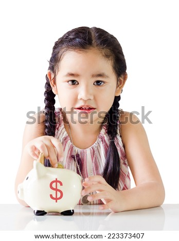 Little girl thinking about saving putting money on a piggy bank.isolated on white background