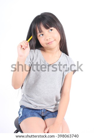 Little girl thinking on white background. - stock photo
