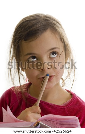 Little girl thinking what she can write in her diary