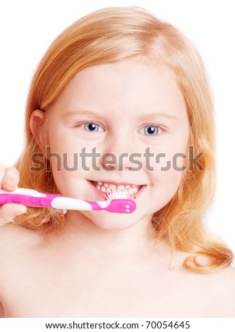 Little girl thinking while washing teeth