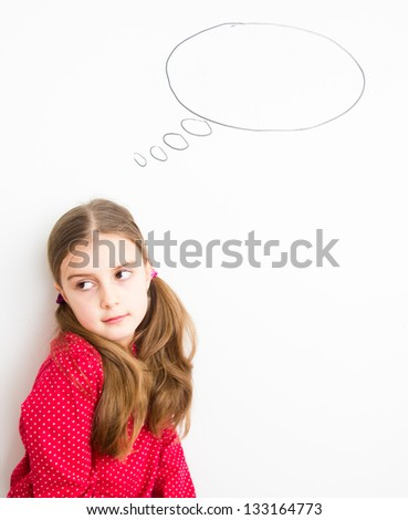little girl thinking with a cloud over her head