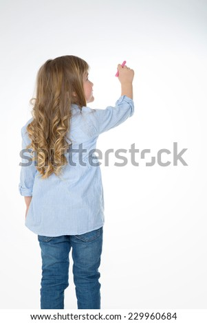 little girl thinks about her next drawing - stock photo