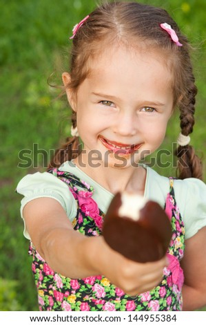 Little girl to share ice cream on the outdoors summer