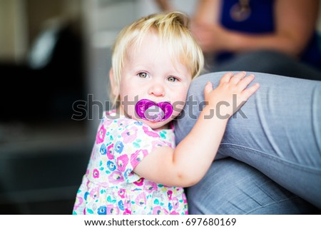 Little girl toddler with pacifier dummy soother
